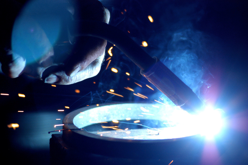 Welding at a machine shop in Edmonton, Alberta. Photo by Daniel Hayduk