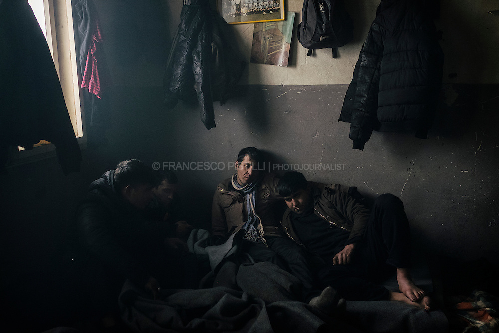 "Early morning. A group of Afghan stranded in Belgrade, Serbia. By the railway station in downtown Belgrade, the temporary citizens-from-nowhere are living their nomad existences in the the rubble of the so-called Belgrade ""Waterfront"" construction project."