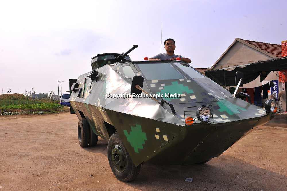 RIZHAO, CHINA - OCTOBER 08: (CHINA OUT) <br /> <br /> Shi Yanqiang presents his home-made armored vehicle on October 8, 2015 in Rizhao, Shandong Province of China. Shi Yanqiang used to be a soldier and he likes military vehicles very much. Shi bought a scrap light truck this March and spent 7 months and 30,000 yuan (4,700 USD) modifying it. The armored vehicle has attracted many visitors since its completion. <br /> ©Exclusivepix Media