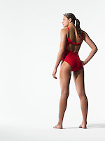 Female swimmer standing back view