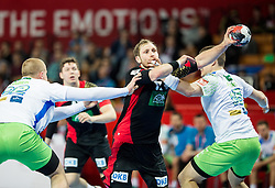 Steffen Weinhold of Germany faulted by Vid Poteko of Slovenia during handball match between National teams of Germany and Slovenia on Day 6 in Preliminary Round of Men's EHF EURO 2016, on January 20, 2016 in Centennial Hall, Wroclaw, Poland. Photo by Vid Ponikvar / Sportida