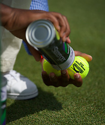 LONDON, ENGLAND - Monday, July 8, 2019: An umpire holds a tin of new balls during the Ladies' Singles fourth round match on Day Seven of The Championships Wimbledon 2019 at the All England Lawn Tennis and Croquet Club. (Pic by Kirsten Holst/Propaganda)