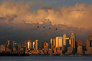 The autumn sun illuminates the Seattle skyline and dramatic clouds above the city. <br />