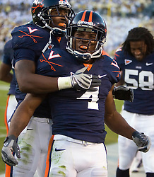 Virginia cornerback Vic Hall (4) celebrates with teammates on the sidelines after he intercepted a Georgia Tech quarterback Josh Nesbitt (9) pass at the end of the fourth quarter to seal the victory for UVA.  The Virginia Cavaliers defeated the #18 ranked Georgia Tech Yellow Jackets 24-17 in NCAA Division 1 Football at Bobby Dodd Stadium on the campus of Georgia Tech in Atlanta, GA on October 25, 2008.