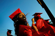 Dominique Rue, along with her fellow graduates, make the walk to their seats during the start of Woodbridge's commencement ceremony held at the Woodbridge High School football field in Woodbridge, New Jersey on June 25, 2009.