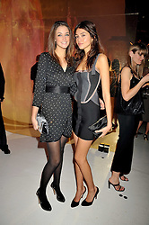 Left to right, VIOLET BUDD and JAMIE GUNNS at the Moet & Chandon Tribute to Cinema party held at the Big Sky Studios, Brewery Road, London N7 on 24th March 2009.