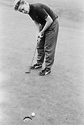 Peter McGowan playing golf, London, UK, 1985