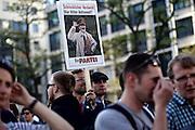 Frankfurt am Main | 21 Apr 2015<br /> <br /> Am Dienstag (21.04.2015) hielt die rassistische und islamfeindliche Gruppe PEGIDA (Patriotische Europ&auml;er gegen die Islamisierung des Abendlandes) an der Hauotwache neben der Katharinenkirche in Frankfurt am Main eine Mahnwache unter dem Motto &quot;Wir sind wieder da&quot; ab. Die Kundgebung war wie immer mit Hamburger Gittern abgesperrt und von starken Polizeikr&auml;ften bewacht. Etwa 1000 Menschen nahmen an den Gegenprotesten teil.<br /> Hier: Aktivist der Partei &quot;Die Partei&quot; mit einem Plakat mit einem Foto von Adolf Hitler und der Aufschrift &quot;Schrecklicher Verdacht: War Hitler Antisemit?&quot;.<br /> <br /> &copy;peter-juelich.com<br /> <br /> [Foto Honorarpflichtig | No Model Release | No Property Release]