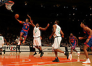Stephon Marbury of the New York Knicks takes a layup ahead of Al Jefferson of the Boston Celtics at Madison Square Garden in New York City. Sunday 04 December 2005 The Knicks won the game 102-99 Photo by Andrew Gombert for the New York Times