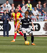 12th May 2018, Dens Park, Dundee, Scotland; Scottish Premier League football, Dundee versus Partick Thistle; Simon Murray of Dundee races away from Miles Storey of Partick Thistle