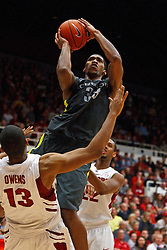 Feb 19, 2012; Stanford CA, USA; Stanford Cardinal forward/center Josh Owens (13) is fouled by Oregon Ducks forward Carlos Emory (33) on a charge during the second half at Maples Pavilion. Oregon defeated Stanford 68-64. Mandatory Credit: Jason O. Watson-US PRESSWIRE