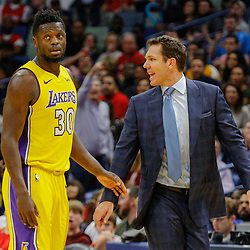Feb 14, 2018; New Orleans, LA, USA; Los Angeles Lakers head coach Luke Walton is held back by forward Julius Randle (30) during the second quarter against the New Orleans Pelicans at the Smoothie King Center. Mandatory Credit: Derick E. Hingle-USA TODAY Sports