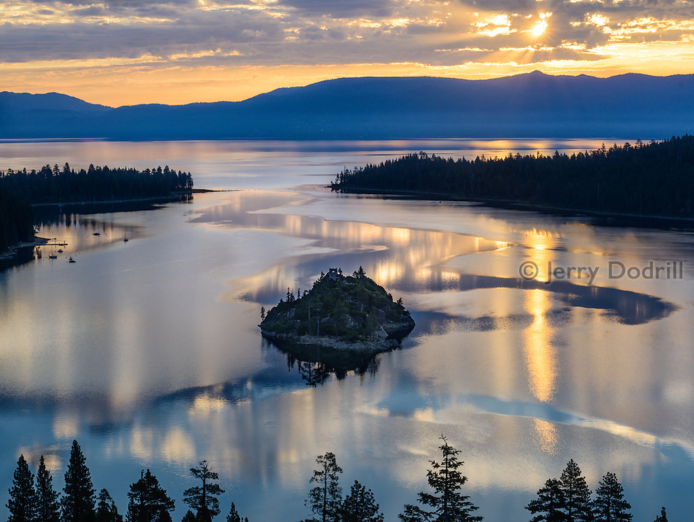 The sun rises above Emerald Bay and Lake Tahoe in the Sierra Nevada Mountains, California
