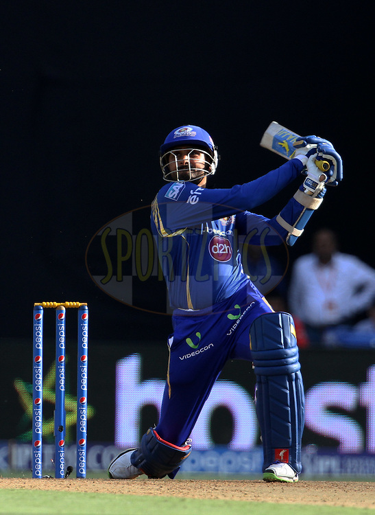Mumbai Indians player Harbhajan Singh plays a shot during match 23 of the Pepsi IPL 2015 (Indian Premier League) between The Mumbai Indians and The Sunrisers Hyderabad held at the Wankhede Stadium in Mumbai India on the 25th April 2015.<br /> <br /> Photo by:  Vipin Pawar / SPORTZPICS / IPL