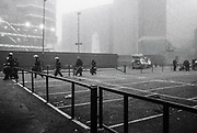 The riot police make their way through a carpark, Scumoween, Whitgift Street, Lambeth, London, UK, 31 October, 2015