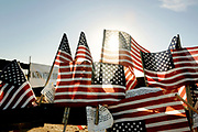 Flags and notes of support remain on an earllier wire fence before a large metal was constructed near the property of Glenn Spencer of the American Border Patrol, Hereford, Arizona, USA.  Spencer monitors smuggling activity along the U.S./Mexico border.