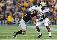 November 10 2012: Purdue Boilermakers wide receiver Antavian Edison (13) pulls in a pass as Iowa Hawkeyes cornerback Micah Hyde (18) defends during the NCAA football game between the Purdue Boilermakers and the Iowa Hawkeyes at Kinnick Stadium in Iowa City, Iowa on Saturday, November 10, 2012. Purdue defeated Iowa 27-24.