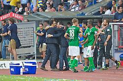 10.08.2013, Eintracht Stadion, Braunschweig, GER, 1. FBL, Eintracht Braunschweig vs SV Werder Bremen, 1. Runde, im Bild Robin Dutt (Cheftrainer SV Werder Bremen), Thomas Eichin (Geschaeftsfuehrer Sport, SV Werder Bremen) und Damir Buric (Co-Trainer SV Werder Bremen) liegen sich nach dem Abpfiff jubelnd in den Armen  during the German Bundesliga 1st round match between Eintracht Braunschweig and SV Werder Bremen at the Eintracht stadium, Braunschweig, Germany on 2013/08/10. EXPA Pictures © 2013, PhotoCredit: EXPA/ Andreas Gumz <br /> <br /> *****ATTENTION - OUT OF GER*****