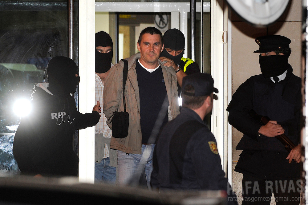 Former leader of banned Basque party Batasuna, Arnaldo Otegi (C) is arrested during an operation against the new Mesa Nacional (National Board) of Batasuna, on October 13, 2009, in the northern spanish Basque city of San Sebastian. Otegi and other 8 people were arrested by Spanish National Police following orders of Spanish Judge Baltasar Garzon. PHOTO/Rafa Rivas