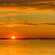 Sunrise between Lifeboat Station and Whaleback Lighthouse at entrance to Portsmouth Harbor, viewed from New Castle, NH