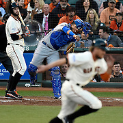 Kansas City Royals catcher Salvador Perez throws out San Francisco Giants right fielder Hunter Pence (8) who was trying to steal second base during the second inning in Game 3 of the World Series on Friday, October 24, 2014 at AT&T Park in San Francisco, Calif.