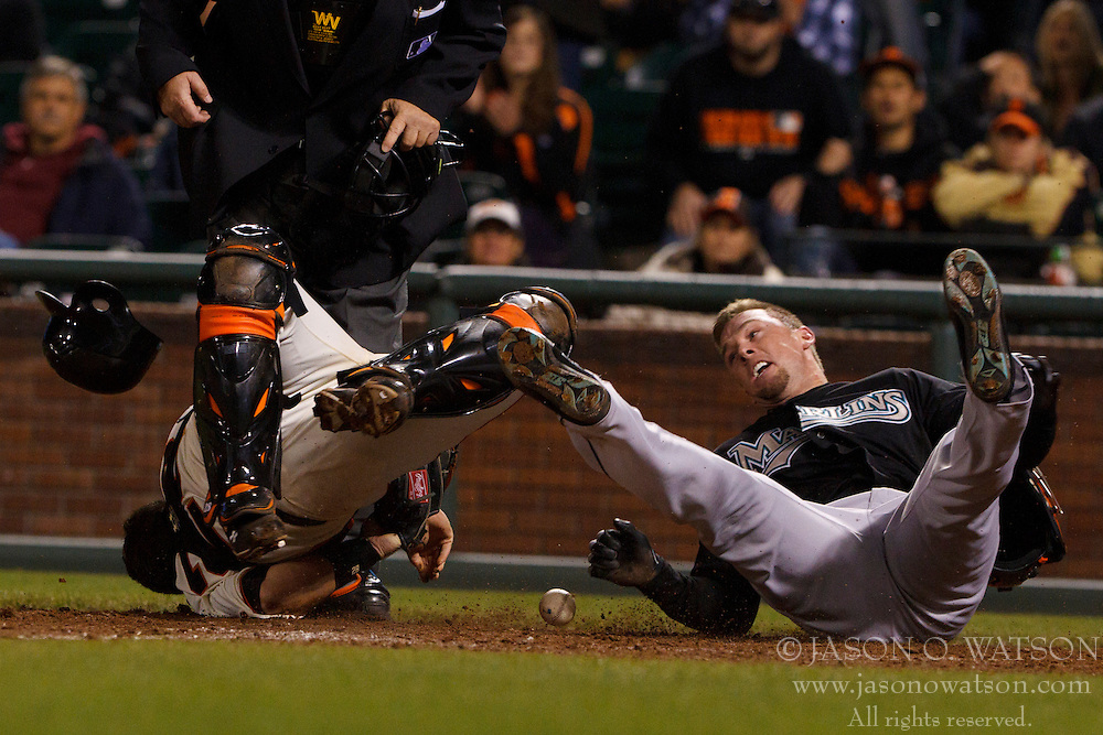 May 25, 2011; San Francisco, CA, USA;  Florida Marlins center fielder Scott Cousins (right) collides with San Francisco Giants catcher Buster Posey (28) to score a run during the twelfth inning at AT&T Park.