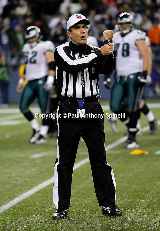NFL referee Pete Morelli (135) calls a holding penalty during the NFL week 13 football game against the Philadelphia Eagles on Thursday, December 1, 2011 in Seattle, Washington. The Seahawks won the game 31-14. ©Paul Anthony Spinelli