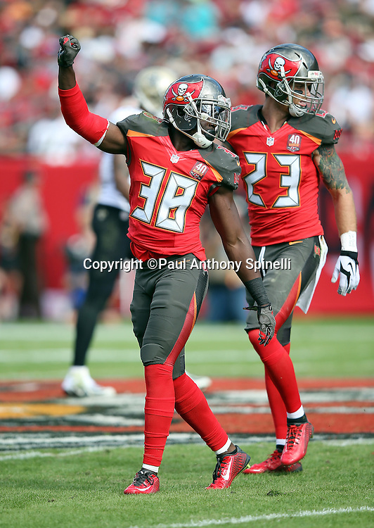 Tampa Bay Buccaneers cornerback Jude Adjei-Barimah (38) raises his arm in celebration as Tampa Bay Buccaneers strong safety Chris Conte (23) looks on during the 2015 week 14 regular season NFL football game against the New Orleans Saints on Sunday, Dec. 13, 2015 in Tampa, Fla. The Saints won the game 24-17. (©Paul Anthony Spinelli)