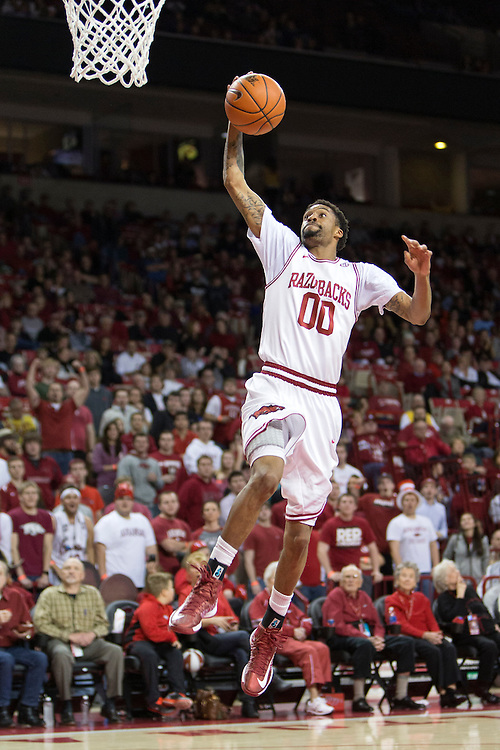 FAYETTEVILLE, AR - JANUARY 23:  Rashad Madden #00 of the Arkansas Razorbacks goes up for a lay up during a game against the Mississippi State Bulldogs at Bud Walton Arena on January 23, 2013 in Fayetteville, Arkansas. The Razorbacks defeated the Bulldogs 96-70.  (Photo by Wesley Hitt/Getty Images) *** Local Caption *** Rashad Madden