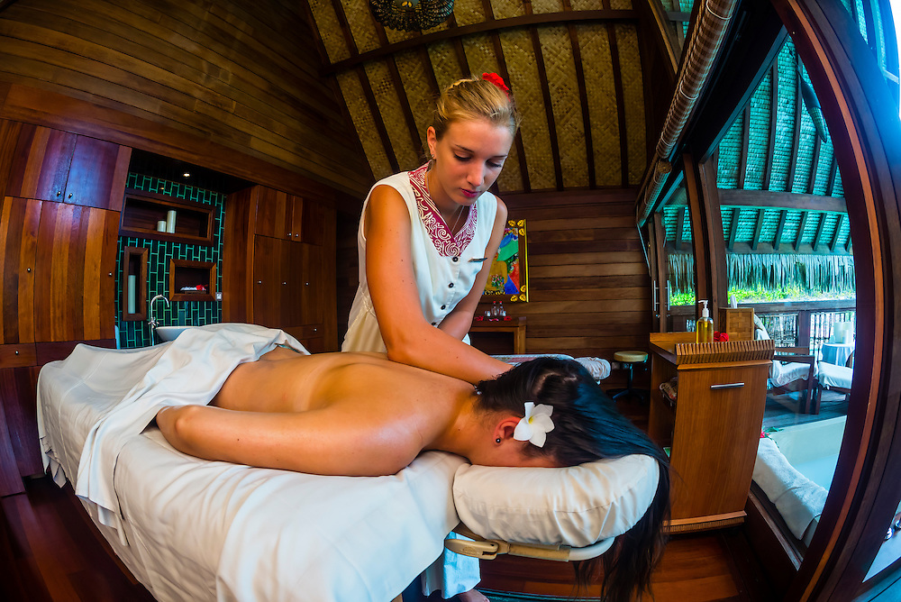 A woman getting a massage in the Kahaia spa suite at the Spa in the Four Seasons Resort Bora Bora, French Polynesia.