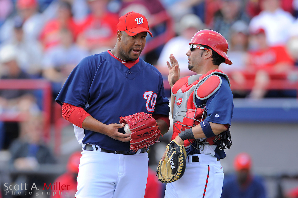 March 14, 2010; Viera, FL, USA; Washington Nationals pitcher Livan Hernandez (61) talks with catcher Wil Nieves (23) during the Nationals game against the St. Louis Cardinals at Space Coast Stadium. ©2010 Scott A. Miller