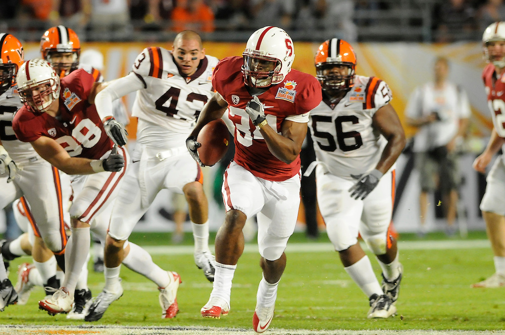 January 3, 2011: Jeremy Stewart of the Stanford Cardinal runs past Jeron Gouveia-Winslow (43) and Antoine Hopkins (56) of the Virginia Tech Hokies for a touchdown during the NCAA football game between the Stanford Cardinal and the Virginia Tech Hokies at the 2011 Orange Bowl in Miami Gardens, Florida. Stanford led Virginia Tech 13-12 at the half.