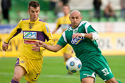 Elvedin Dzinic of Maribor and Senad Tiganj of Olimpija at 13th Round of Prva Liga football match between NK Olimpija and Maribor, on October 17, 2009, in ZAK Stadium, Ljubljana. Maribor won 1:0. (Photo by Vid Ponikvar / Sportida)