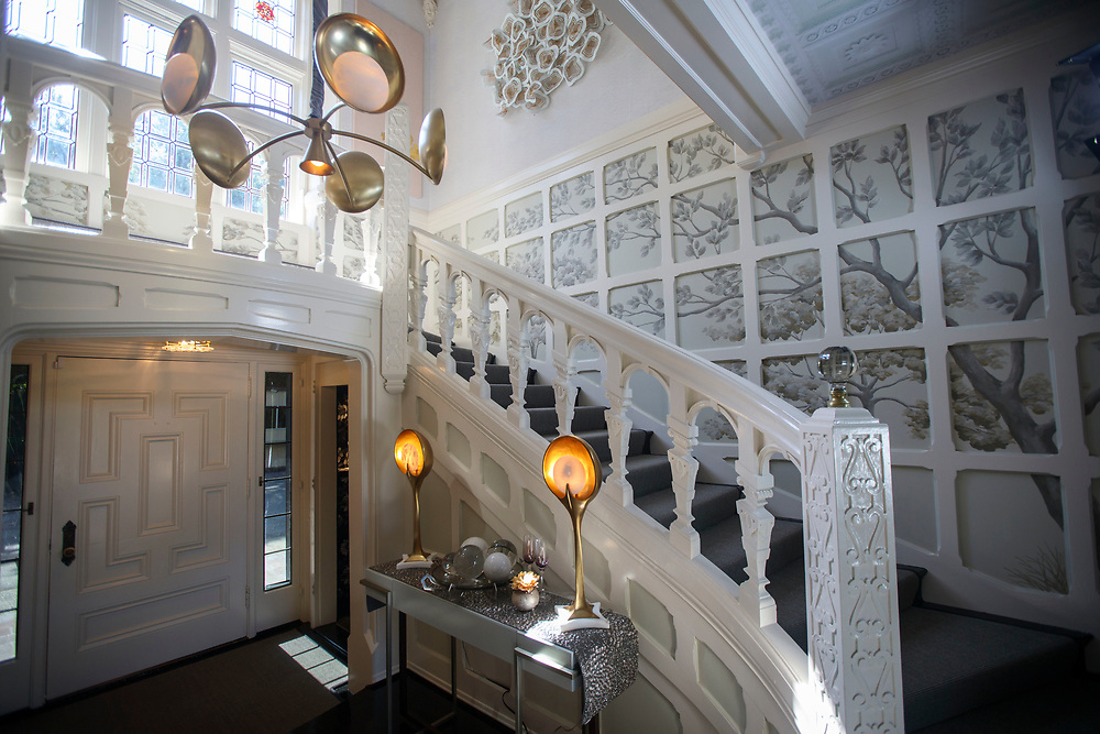 The main staircase - by L'Esperance Design - after renovations inside the Pasadena Showcase House of Design on Wednesday, April 12, 2017 in Pasadena, Calif. The 1916 English estate home was updated for modern living by interior and landscape designers. © 2017 Patrick T. Fallon
