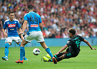 EDINBURGH, SCOTLAND - JULY 28: <br /> Liverpool and England midfielder,Alex Oxlade-Chamberlain, shoots for goal during the Pre-Season Friendly match between Liverpool FC and SSC Napoli at Murrayfield on July 28, 2019 in Edinburgh, Scotland. (Photo by MB Media)