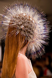 © Licensed to London News Pictures. 30/05/2013. London, England. Womenswear Millinery collection by Maiko Takeda. Students from the Royal College of Art's MA Fashion prgramme presented their final collections to press and trade. The catwalk show featured 33 collections by students specialising in Menswear, Womenswear, Knitwear and Millinery. Photo credit: Bettina Strenske/LNP