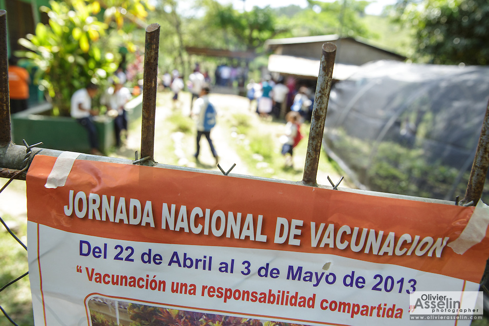 Poster advertising national vaccination days at the primary school in the town of Coyolito, Honduras on Wednesday April 24, 2013.