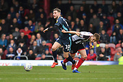 Bury FC midfileder Danny Mayor (10) and Grimsby Town midfielder Jake Hessenthaler(7) during the EFL Sky Bet League 2 match between Grimsby Town FC and Bury at Blundell Park, Grimsby, United Kingdom on 23 March 2019.