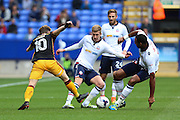 Bradford City striker Billy Clarke (10), Bolton Wanderers midfielder Liam Trotter (17) and Bolton Wanderers midfielder Josh Vela (6) challenge for the ball during the EFL Sky Bet League 1 match between Bolton Wanderers and Bradford City at the Macron Stadium, Bolton, England on 24 September 2016. Photo by Simon Brady.