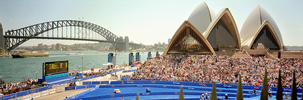 A panoramic image of Simon Whitfield of Canada winning the Men's triathlon gold medal as he heads for the race finish in front of the Sydney Opera House with the Sydney Harbour Bridge providing a stunning backdrop during the  2000 Sydney Olympic Games...Panoramic images from the Sydney Olympic Games, Sydney, Australia. 2000 . Photo Tim Clayton
