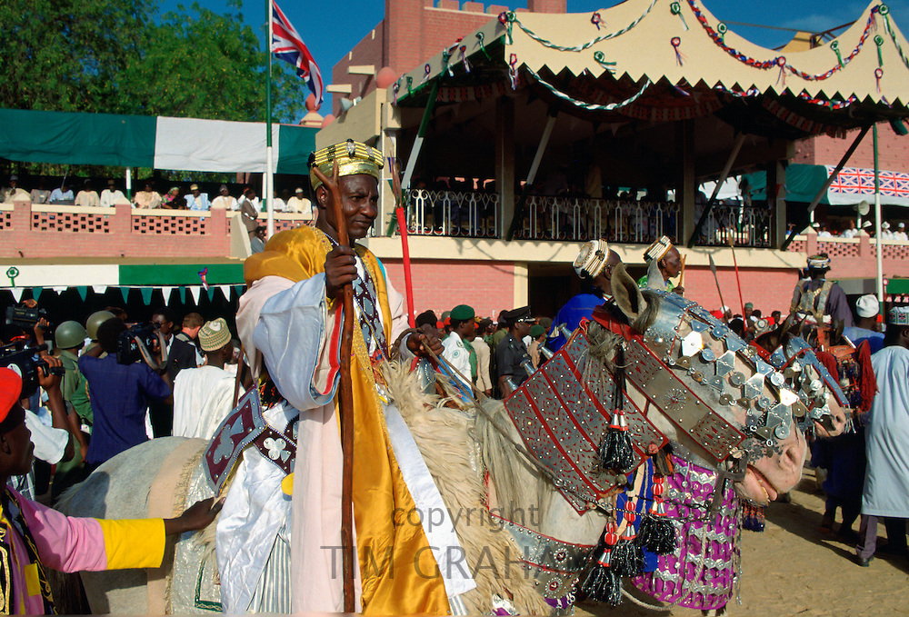 A n honoured chief ridingon a decorated horse and holding a staff at a Durbar in Maidugari, Nigeria