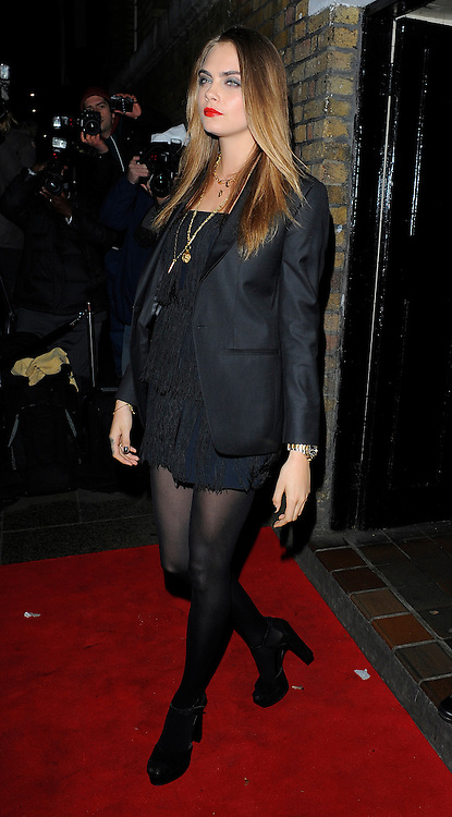 Model Cara Delevingne attends the YSL Beauty: YSL Loves Your Lips party at The Boiler House,The Old Truman Brewer in London, UK. 20/01/2015<br />BYLINE MUST READ : GOTCHAIMAGES.COM<br /><br />Copyright by &copy; Gotcha Images Ltd. All rights reserved.<br />Usage of this image is conditional upon the acceptance <br />of Gotcha Images Ltd, terms and conditions available at<br />www.gotchaimages.com