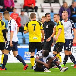 TELFORD COPYRIGHT MIKE SHERIDAN 13/10/2018 - Telford players surround the referee after Daniel Udoh (in foreground) of AFC Telford is dragged down by Matt Challoner (left) during the Vanarama National League North fixture between AFC Telford United and Chorley