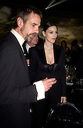 Jeremy irons, Monica Belluci and the president of Cartier Bernard Fornas, Party to celebrate 100 years of the Santosd de Cartier watch. Le Bourget airport. Paris. 7 April 2004. SUPPLIED FOR ONE-TIME USE ONLY> DO NOT ARCHIVE. © Copyright Photograph by Dafydd Jones 66 Stockwell Park Rd. London SW9 0DA Tel 020 7733 0108 www.dafjones.com