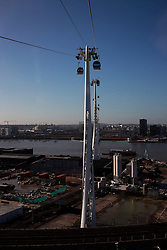 UK ENGLAND LONDON 27FEB15 - View of the Emirates Air Line cable car across the river Thames, London. Operated by Transport for London, the service comprises a 1-kilometre (0.62 mi) gondola line that crosses the Thames from the Greenwich Peninsula to the Royal Docks. <br /> <br /> jre/Photo by Jiri Rezac<br /> <br /> © Jiri Rezac 2015