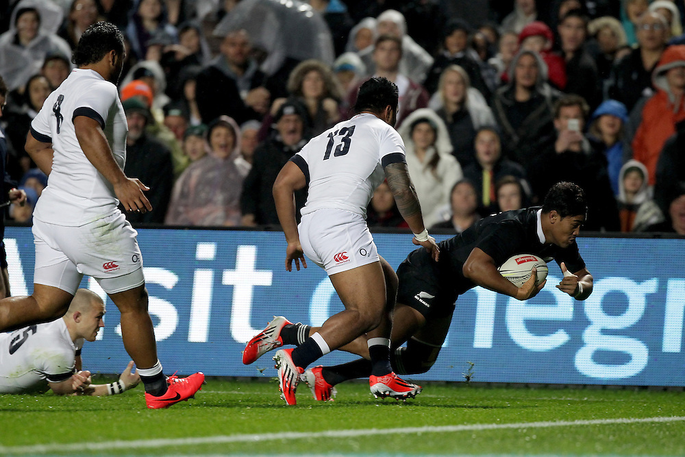 New Zealand's Julian Savea beats England's Manu Tuilagi to score a try in an International Rugby Test match, Waikato Stadium, Hamilton, New Zealand, Saturday, June 21, 2014.  Credit:SNPA / David Rowland
