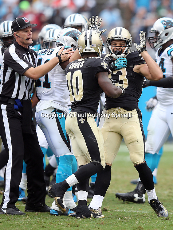 New Orleans Saints wide receiver Willie Snead (83) gets restrained by New Orleans Saints wide receiver Brandin Cooks (10) after getting into a scuffle with Carolina Panthers free safety Kurt Coleman (20) during the 2015 NFL week 3 regular season football game against the Carolina Panthers on Sunday, Sept. 27, 2015 in Charlotte, N.C. The Panthers won the game 27-22. (©Paul Anthony Spinelli)