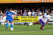 AFC Wimbledon midfielder Anthony Hartigan (8) shoots at goal and Shrewsbury Town defender Ro-Shaun Williams (5) is in the air trying to block during the EFL Sky Bet League 1 match between AFC Wimbledon and Shrewsbury Town at the Cherry Red Records Stadium, Kingston, England on 14 September 2019.