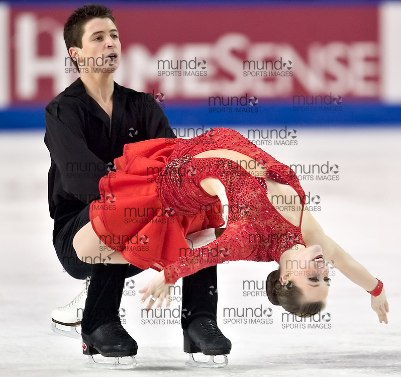 Ottawa, Ontario ---06/1/15--- Tessa Virtue and Scott Moir skate their free dance in the senior dance competition at the Canadian Championships at the Civic Centre in Ottawa Sunday January 15, 2006. The pair from the London area finished in third place..GEOFF ROBINS The Ottawa Sun<br />
