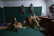 "KURDISTAN, NORTHERN IRAQ, Dokuk.<br /> Qalubna Ma'Kum Feature:<br /> Qalubna Ma'kum (meaning ""Our hearts are With You"") are a group of foreign volunteer fighters who have joined up with the Peshmerga in Kurdistan to help with the battle against Daesh, also known as ISIS. <br /> <br /> Pictured: Co-founders of Qalubna Ma'kum Kat Argo (left) and Francis Cuvelier (right) pass time in their bedroom/office."